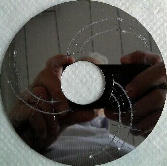 диск с 3-мя спиральными прорезями